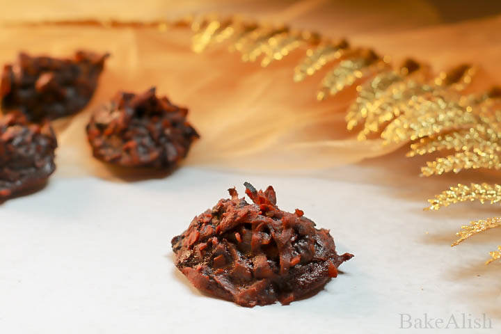 With the goodness of freshly grated coconut and rich melted chocolate, these Chocolate Coconut Macaroons is the best thing you could cheat on. It's rich and moist, makes you feel like you biting into a coconut bounty. The freshly grated coconut adds to its rustic texture and chocolate simply carries the scale higher.