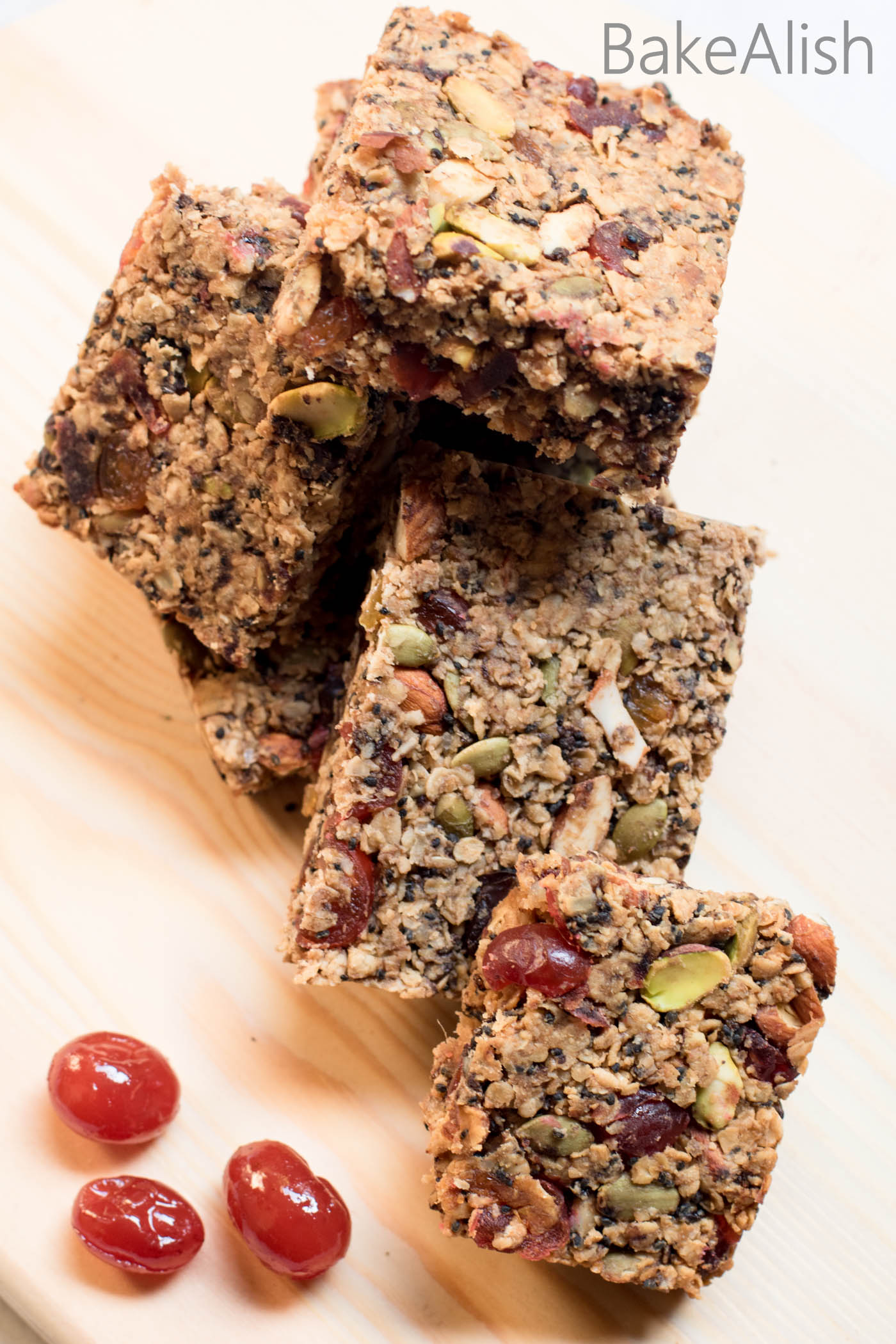 These Fruit And Nut Granola Bars have all the nuts you like and is loaded with dates, raisins and more. Its a very basic granola bar recipe, you can add whatever nuts and dried fruits you'd like in these healthy bars. These simply taste great and is a perfect munching option when you need a snack.