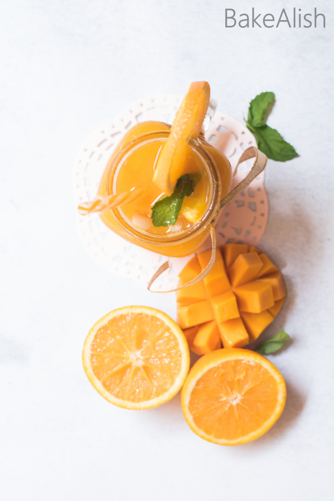 This Sparkling Mango Orange drink is so refreshing and perfect for the summers. Its got the king of all fruits, Mango along with a citrus tinge, Orange. When combined with some sparkling water it takes this punch to the next level. Crushed mint and lots of ice makes this the perfect summer drink.