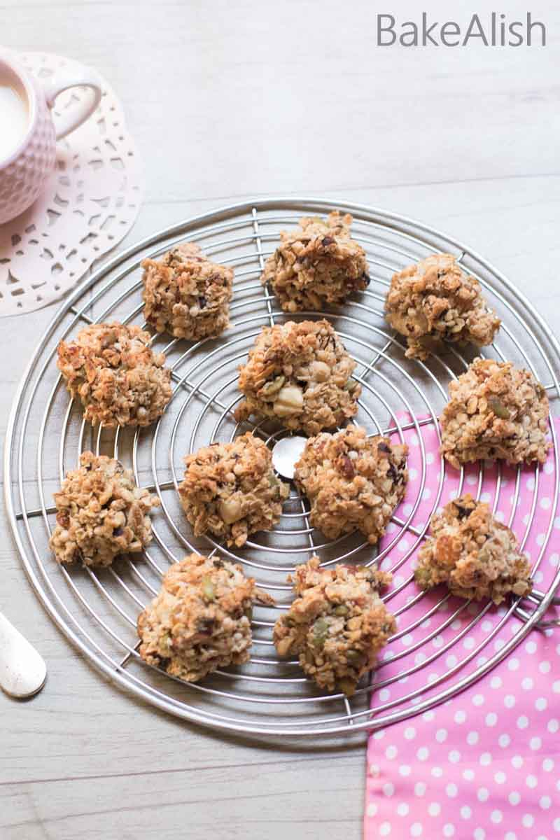 These Granola Cookie Bites are made up of nuts, seeds, coconut, oats and lots of healthy foods. Its delicious and a perfect snack to munch on when hunger strikes. Most of the ingredients are oven toasted and then combined with a meringue and baked, this makes the granola crisp with the crunchy texture.