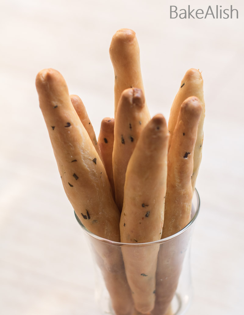 Basil adds a sweet flavor to any dish and cheese just enhances every dish. These Basil Cheese Bread Sticks are crisp on the outside and soft on the inside. Loaded with cheese and basil, these baked breadsticks are fun to make and taste delicious.