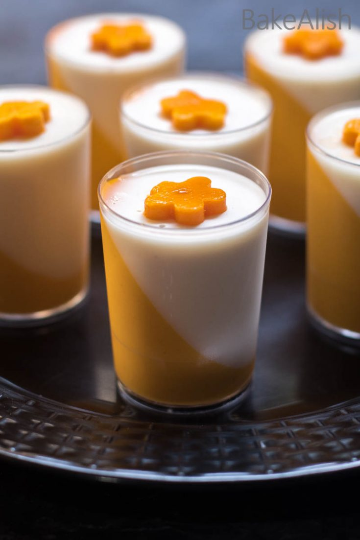 Introducing to you a dessert that looks gorgeous and tastes even better. This Coconut Mango Panna Cotta is a tropical dessert which can never go wrong. Its got a smooth creamy texture that just slips over your tongue leaving a mild coconut essence and a burst of mango flavor.