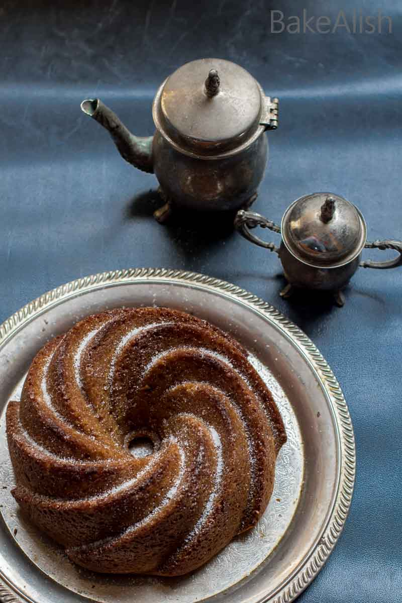 This Masala Chai Cake is moist and delicious with a light essence of aromatic chai combined with spices and lots of roasted hazelnuts.