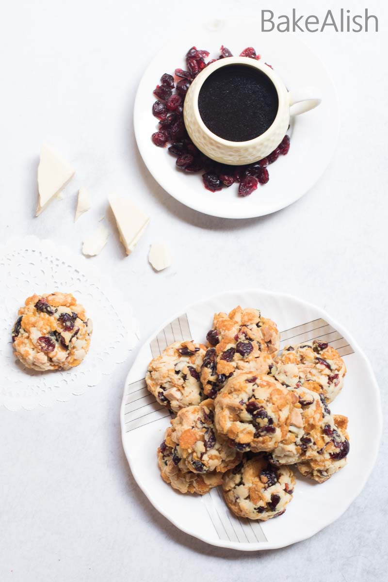 This recipe is a twist to any regular cookie recipe. Its loaded with dried cranberries & crisp cornflakes. These Cranberry Cornflakes Cookies are a must try