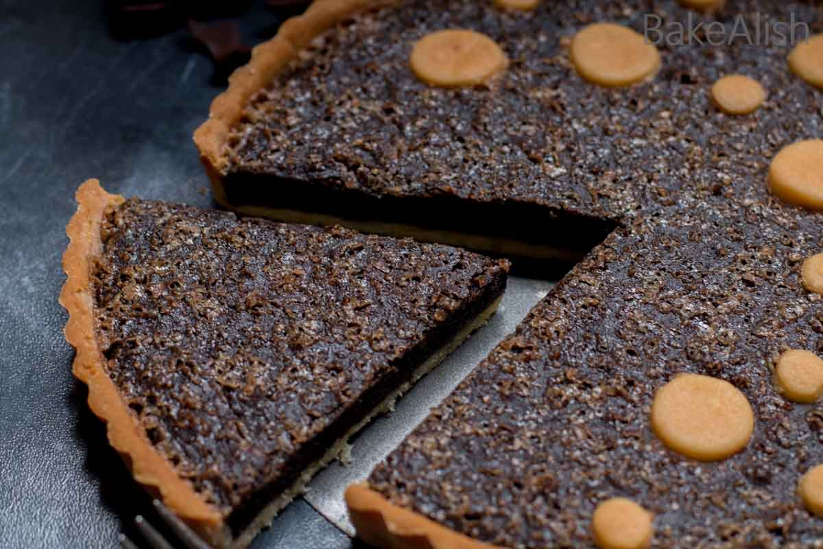 This easy decadent Brownie Tart is a combination of a crisp buttery tart baked with moist and fudgy dark chocolate brownie.
