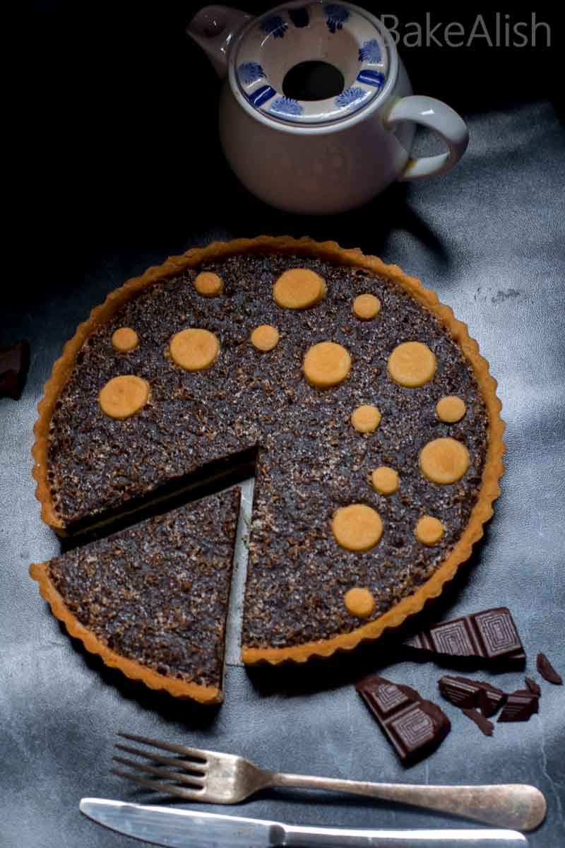 This easy decadent recipe is a combination of a crisp buttery crust baked with moist and fudgy dark chocolate cake