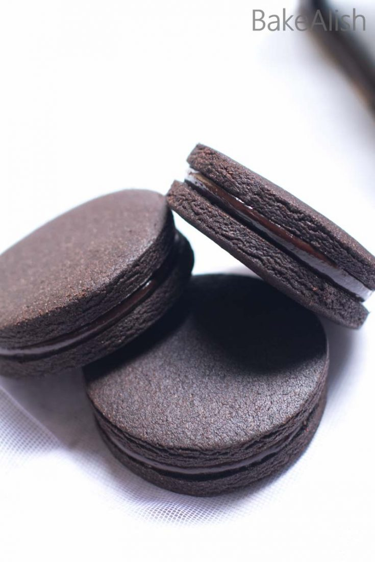 These Chocolate Coffee Cookie Sandwiches is a chocolate lovers dream come true. Every bite of this cookie is rich in flavor with a balance of a crisp bittersweet biscuit and a creamy rich filling. These chunky cookies are the perfect gifting option and even look stunning on a dessert table.