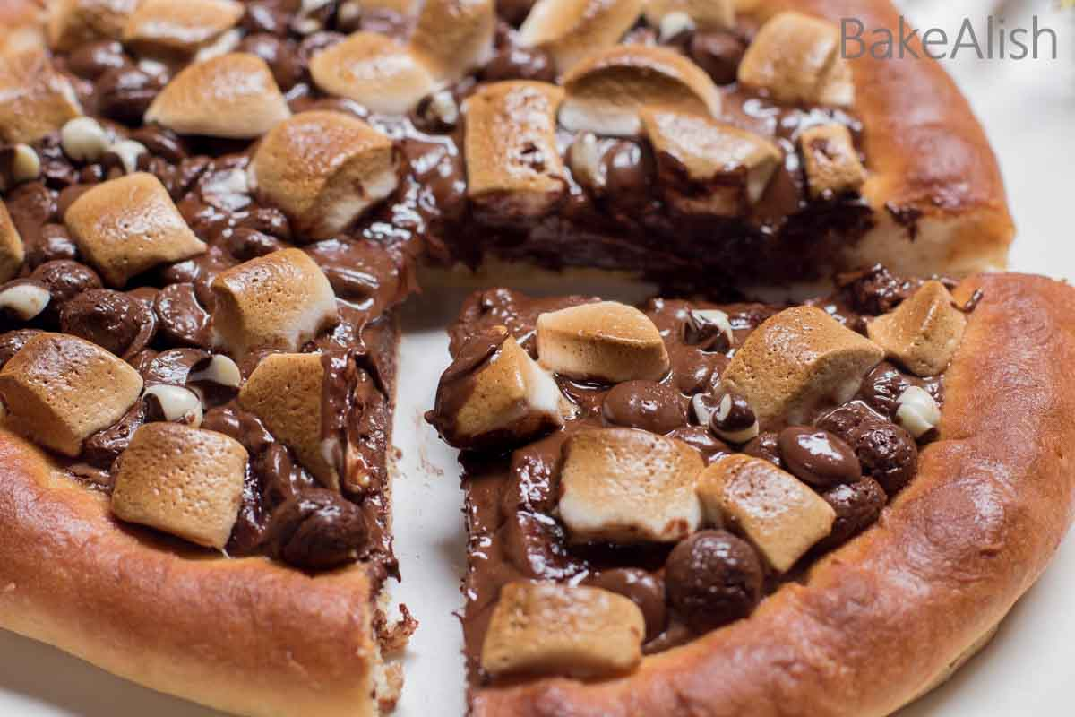 This Chocolate Pizza recipe will leave you drooling over it. It is easy, delicious and irresistible. A must try for every dessert lover