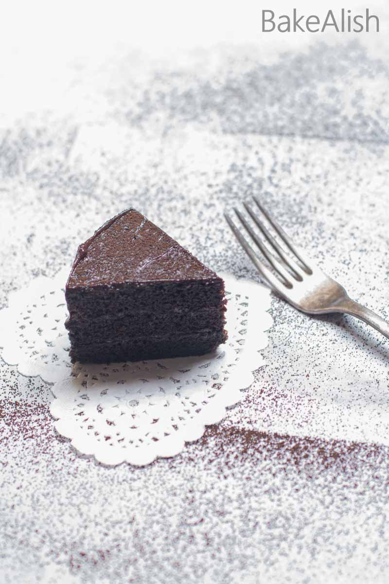 This Eggless Chocolate Sponge Cake is super moist and light. Perfect for icing and frosting purposes. Easy to make, one bowl cake recipe.