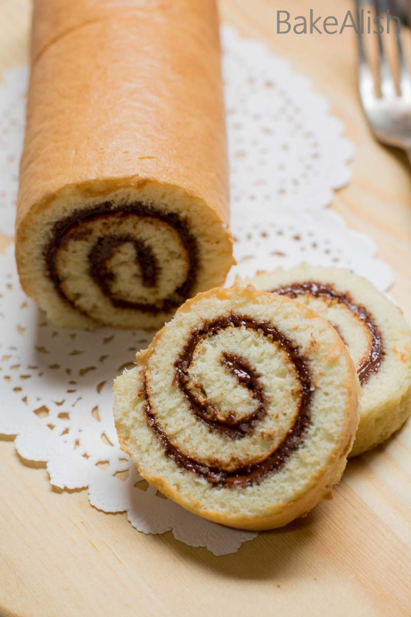 This fluffy cake roll is wrapped with creamy Nutella and is also called Nutella Roulade