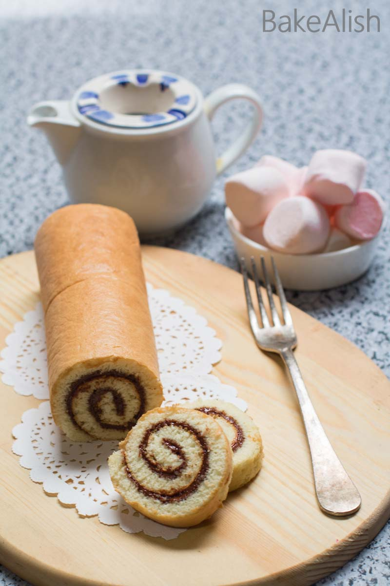 This fluffy cake roll is wrapped with creamy Nutella and taste absolutely divine. Nutella Swiss Roll is an easy, delicious cake recipe you must try.