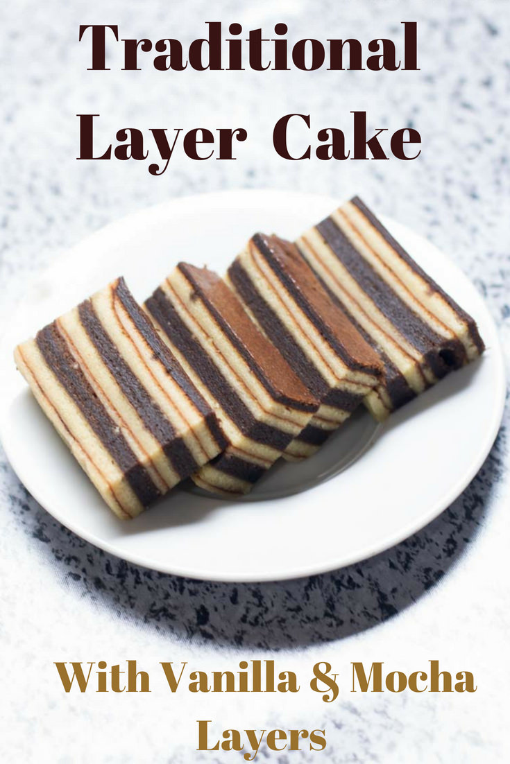Soft, fluffy, moist and full of flavor, this Traditional Layer Cake is worth the effort. Perfect for tea parties and loved by many, this recipe has the right balance of ingredients. It is a combination of moist vanilla layers combined with the dark and delicious mocha layers.