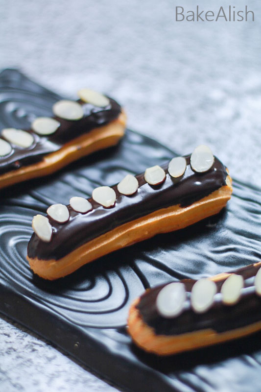 Chocolate Eclairs is an oblong pastry featuring the choux pastry, vanilla pastry cream, and chocolate ganache topping. Check out the recipe video