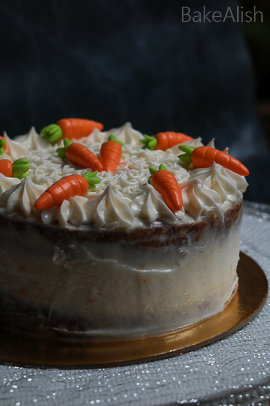 Learn how to make an easy carrot cake recipe which is moist with a creamy cream cheese frosting. This yummy carrot cake is the Best Carrot Cake Recipe