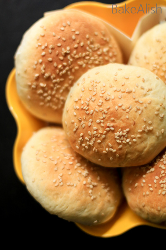 Golden brown eggless buns that are soft and fluffy