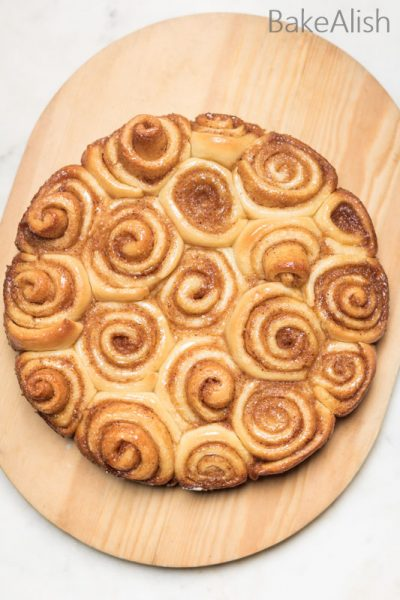 Learn how to make cinnamon rolls with this quick recipe. This easy cinnamon roll is absolutely soft, fluffy and delicious. Rolled with brown sugar and the flavorful spice, these basic ingredients add so much more texture to simple homemade buns