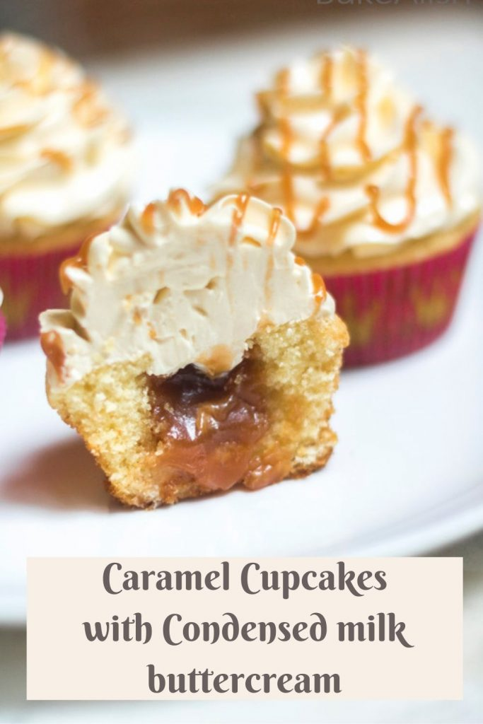 Salted Caramel Cupcakes oozing out of the cupcake that is cut into half