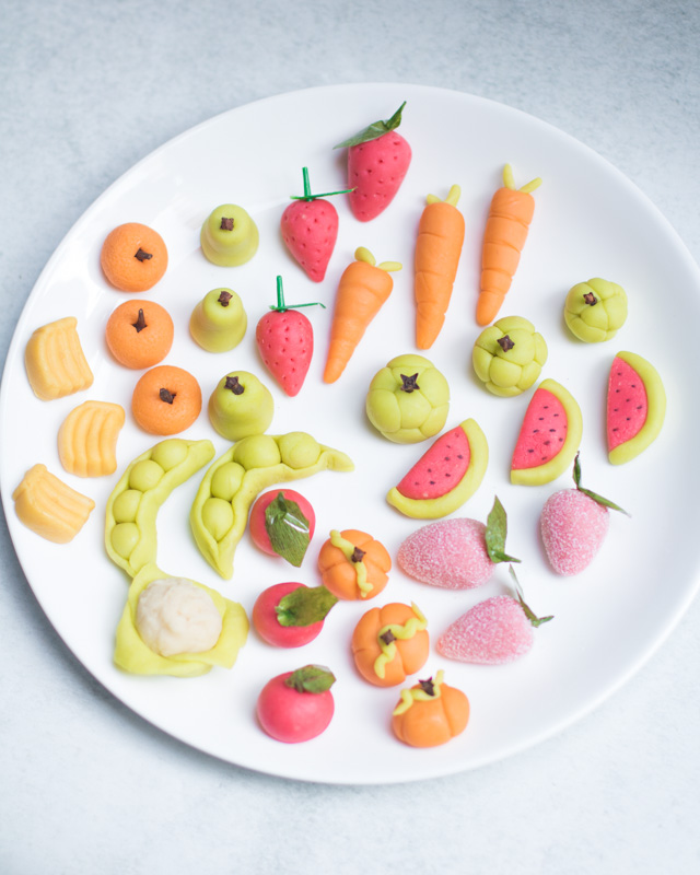 Christmas sweets marzipan on plate in fruit shapes