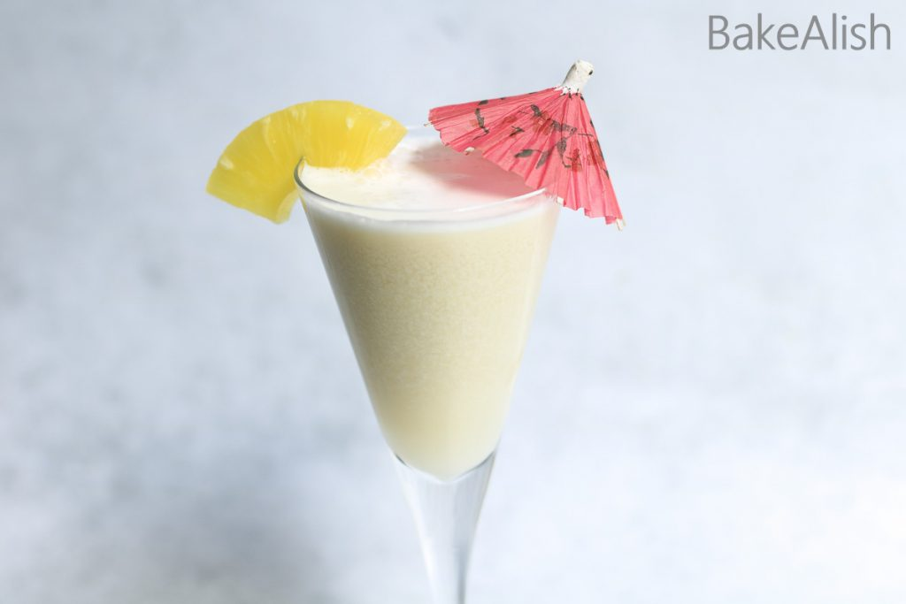 refreshing summer drink made with coconut milk and pine apple chunks