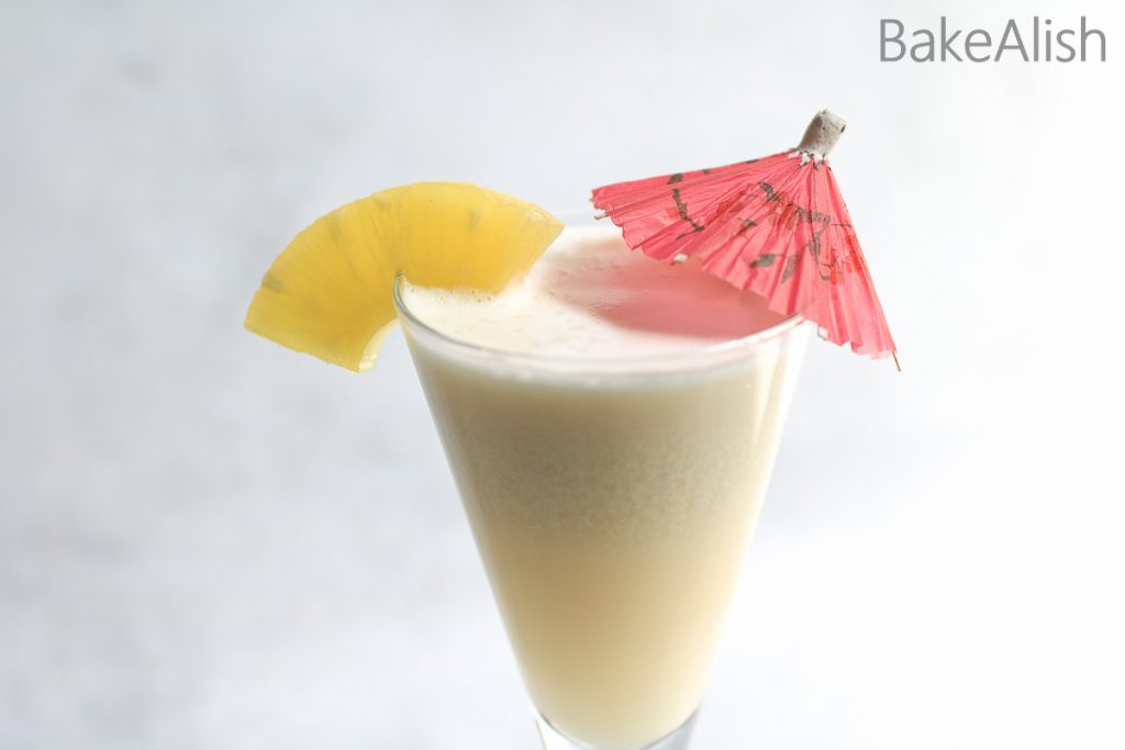 mocktail made with pineapple and coconut with lime