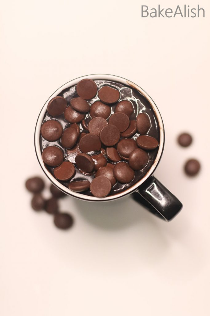 cup topped with chips of chocolates