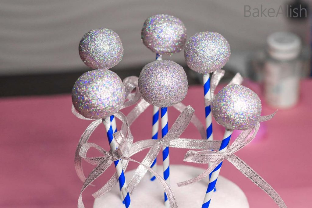 cake pops with silver edible glitter