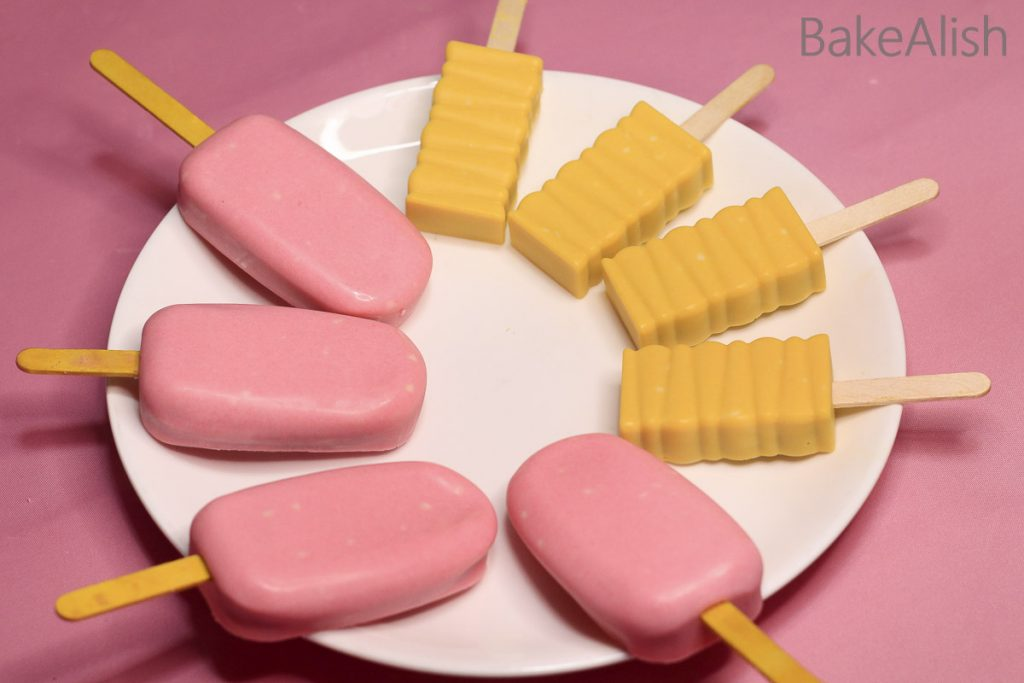 cakesicles with pink and yellow chocolate